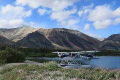Cessna 206 on Wipline 3450 Floats on a Mountain Lake
