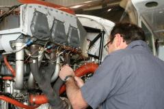 Maintenance technician working on a Cessna 182.