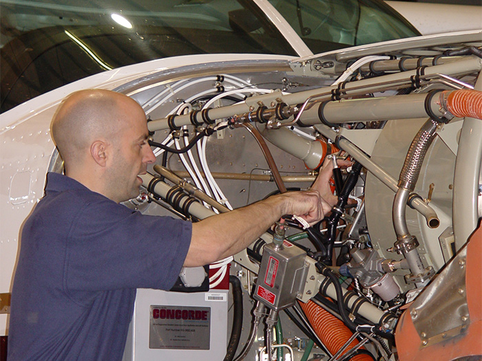 Wipaire maintenance tech working on a Cessna Caravan PT6 engine