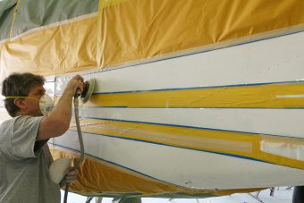 Stripes masked and being abraded for painting