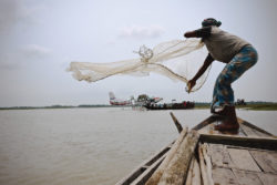 Net Fishing in Bangladesh with a Caravan Seaplane in the Background - Image Copyright MAF