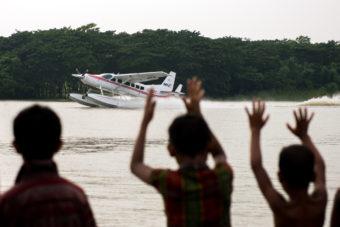 Crowds gather to watch the float plane, Bangladesh - Image Copyright MAF