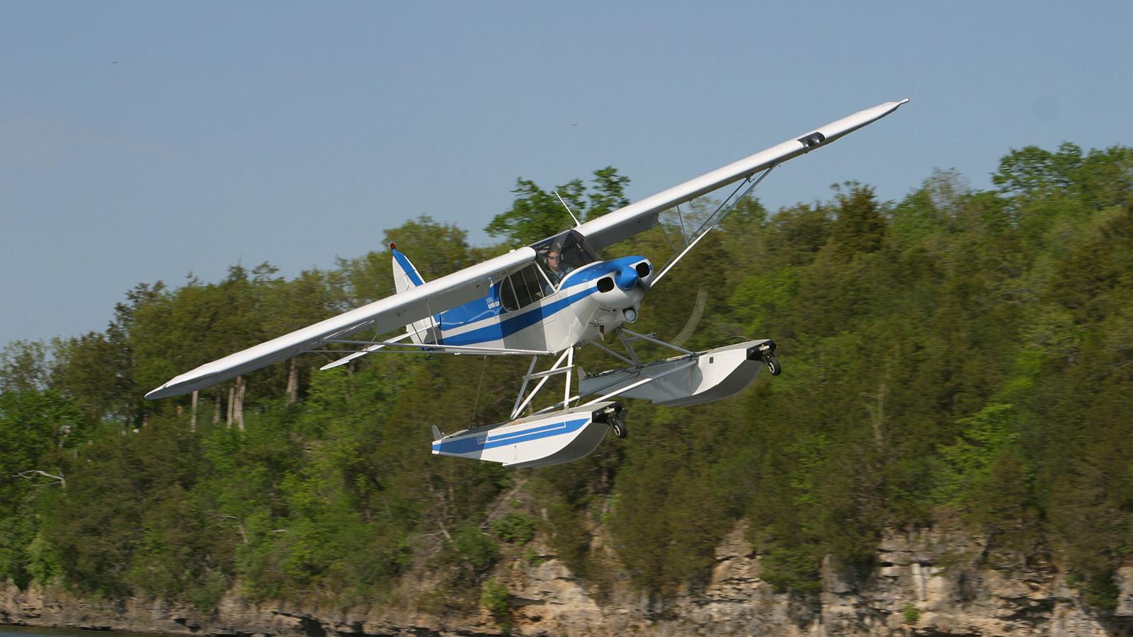 Piper Cub on Wipline 2100 Floats in Flight