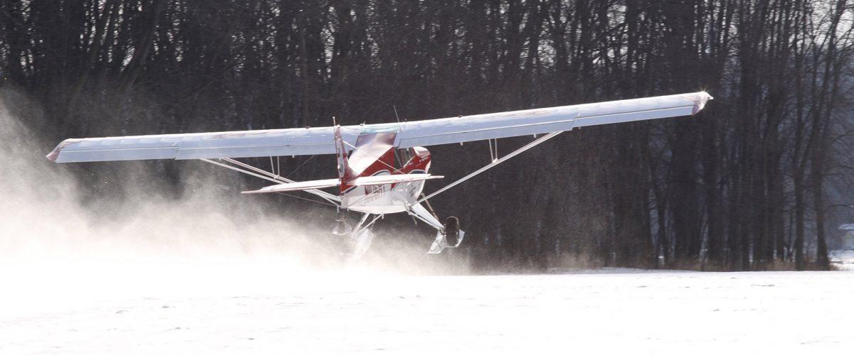 Aviat Husky A1C on C2200 Skis
